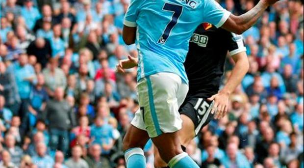 Raheem Sterling scores the first goal for Manchester City yesterday