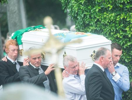 FINAL JOURNEY: Family members carry the white coffin of avid athlete and hurler Donal English-Hayden who was tragically killed in a farm accident in Carlow when the tractor he was travelling in toppled over into a ditch
