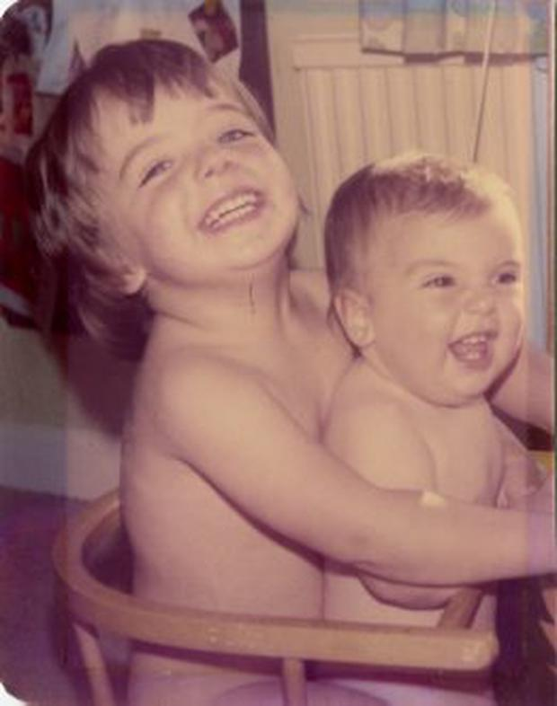 Daniel holds his sister Laura in the bath