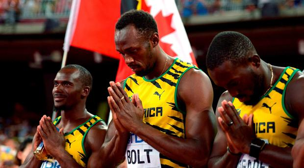 Jamaica's Men's 4x100m relay team of Usain Bolt (centre), Asafa Powell (not pictured), Nickel Ashmeade (right) and Nesta Carter pray ahead of the race during day eight of the IAAF World Championships at the Beijing National Stadium, China. Adam Davy/PA Wire.