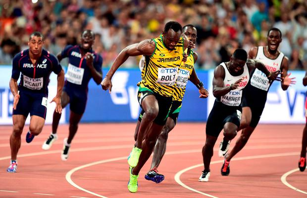 Jamaica on their way to winning the Men's 4x100m relay as Nickel Ashmeade passes the baton to Usain Bolt during day eight of the IAAF World Championships at the Beijing National Stadium, China. Adam Davy/PA Wire.