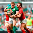 Sean Cronin, Ireland, is tackled by Justin Tipuric, left, and Dan Biggar, Wales