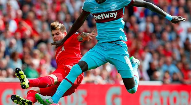 Liverpool's Alberto Moreno in action with West Ham's Cheikhou Kouyate
