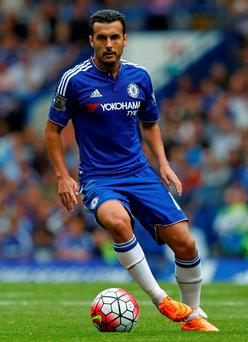 Chelsea's Spanish midfielder Pedro runs with the ball