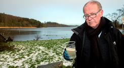 CONTROVERSY: 'Sunday Independent' writer Jim Cusack holds a sample of diesel-sludge- contaminated water taken from a stream near Castleblayney, Co Monaghan