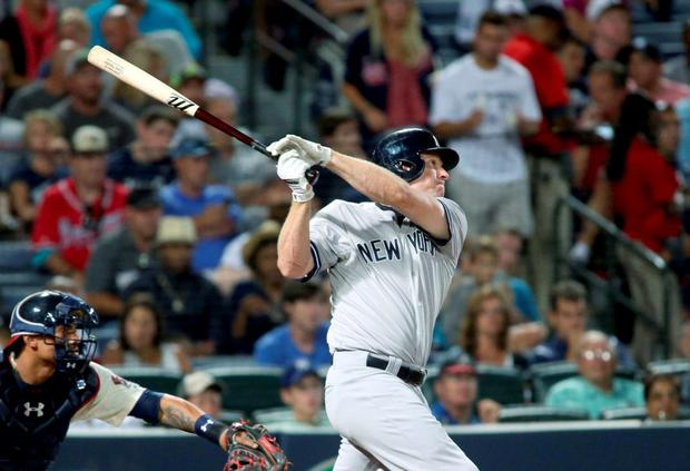 New York Yankees third baseman Chase Headley (12) hits a double in the seventh inning of their game against the Atlanta Braves at Turner Field. The Yankees won 3-1. Mandatory Credit: Jason Getz-USA TODAY Sports