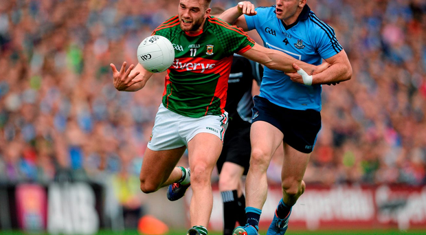 Mayo's Aidan O'Shea in action against Philly McMahon of Dublin.