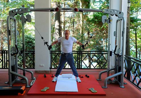Russian President Vladimir Putin exercises in a gym at the Bocharov Ruchei state residence in Sochi, Russia, August 30, 2015. REUTERS/Michael Klimentyev/RIA Novosti/Kremlin