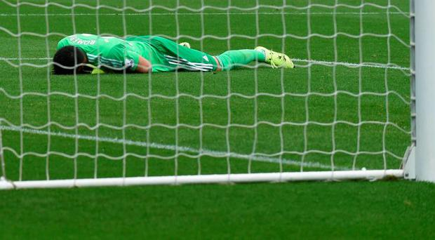 Manchester United's Sergio Romero looks dejected after Bafetimbi Gomis (not pictured) scores the second goal for Swansea