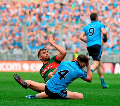 Aidan O'Shea and Philly McMahon clash during yesterday's All-Ireland SFC semi-final