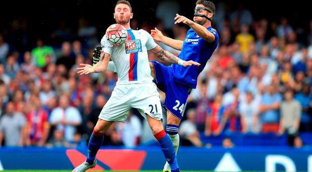 Chelsea's Gary Cahill and Crystal Palace's Connor Wickham battle for the ball