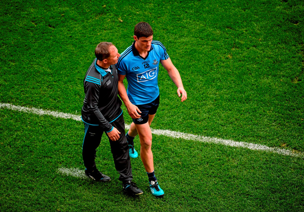 Diarmuid Connolly is greeted by manager Jim Gavin as he leaves the field after being red-carded