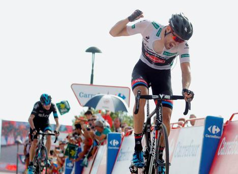 Giant-Alpecin's Dutch cyclist Tom Dumoulin crosses the finish line to win stage nine of the Vuelta and reclaim the leader's jersey