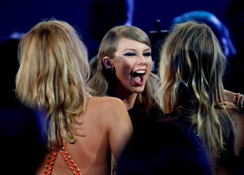 Taylor Swift reacts as she heads to the stage to accept the award for best female video for