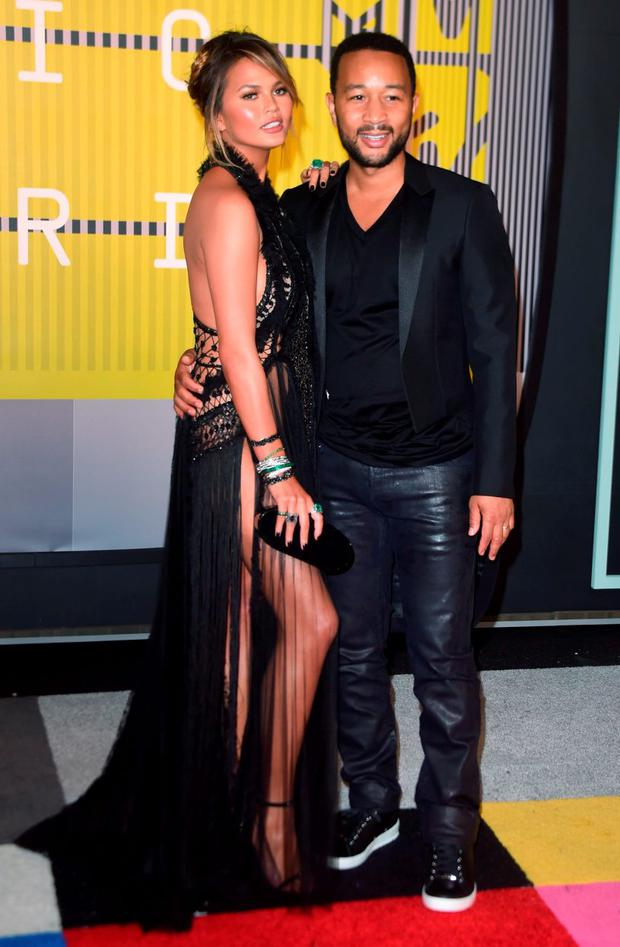 Model Chrissy Teigen and her husband, musician John Legend arrive on the red carpet at the MTV Video Music Awards
