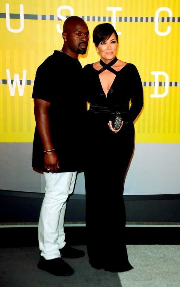 BEST: Kris Jenner (pictured here with Corey Gamble) looks age appropriate for once and is killing it in this black plunging gown.