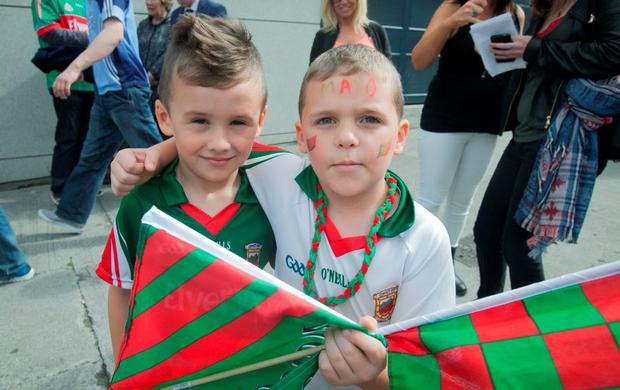GAA fans (L to R) Kacy Mannion 7 & Senan Farrell 7 both from Charlestown at the GAA Semi Final between Dublin & Mayo in Croke Park, Dublin