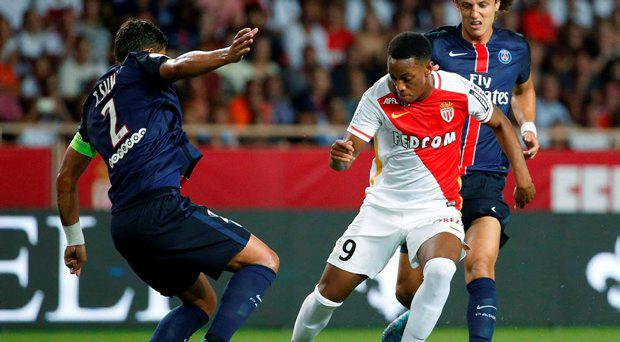 Monaco's Anthony Martial (C) challenges Paris St Germain's Thiago Da Silva (L) and David Luiz during their Ligue 1 soccer match at Louis II stadium in Monaco August 30, 2015