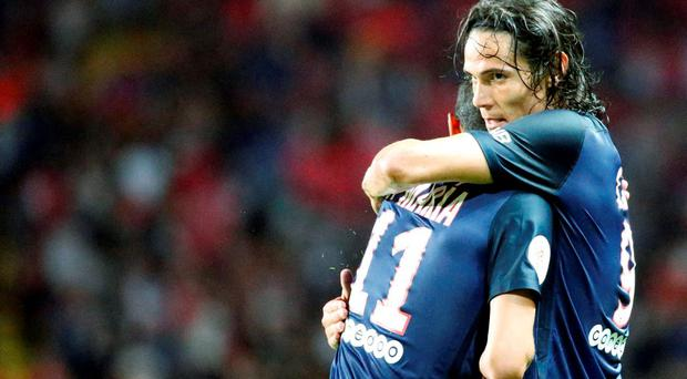 Paris St Germain's Edinson Cavani (R) celebrates with team mate Angel Di Maria after scoring the first goal for the team during their Ligue 1 soccer match against Monaco at Louis II stadium in Monaco last night