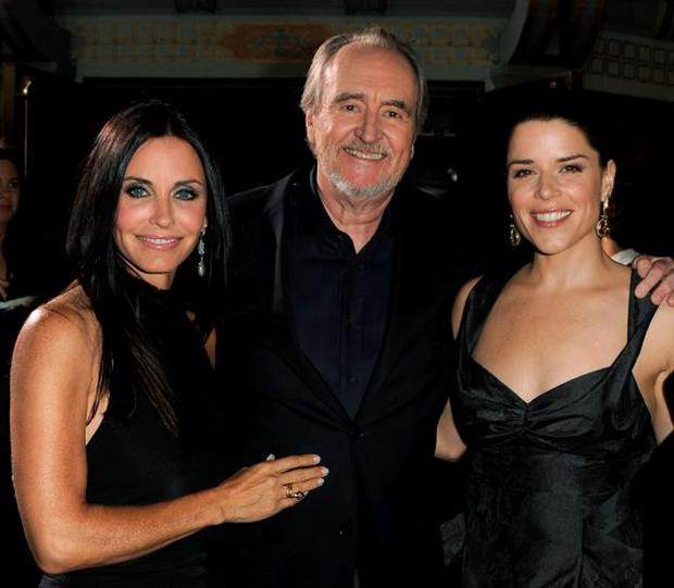 HOLLYWOOD, CA - APRIL 11: Actress Courteney Cox, director Wes Craven, and actress Neve Campbell arrive at the premiere of The Weinstein Company's