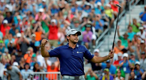 Jason Day, of Australia, celebrates on the 18th green after winning The Barclays golf tournament