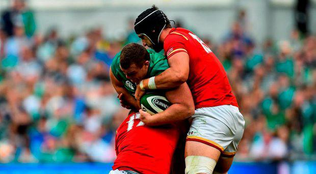 29 August 2015; Jack McGrath, Ireland, is tackled by Paul James, left, and Luke Charteris, Wales. Rugby World Cup Warm-Up Match, Ireland v Wales, Aviva Stadium, Lansdowne Road, Dublin. Picture credit: Ramsey Cardy / SPORTSFILE
