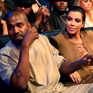 Rapper Kanye West (L) and TV personality Kim Kardashian attend the 2015 MTV Video Music Awards