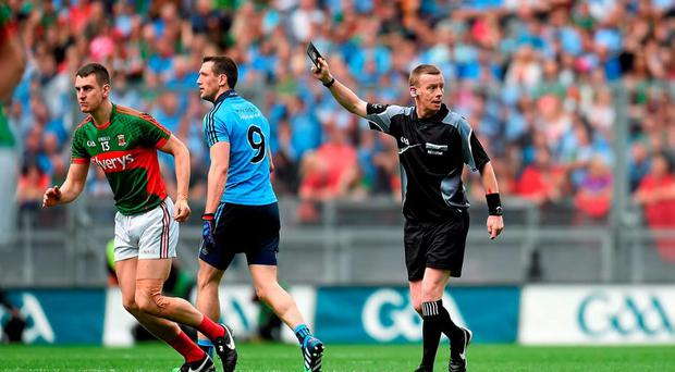 Denis Bastick, Dublin, is shown a black card by referee Joe McQuillan during the second half. GAA Football All-Ireland Senior Championship, Semi-Final, Dublin v Mayo, Croke Park, Dublin. Picture credit: Paul Mohan / SPORTSFILE