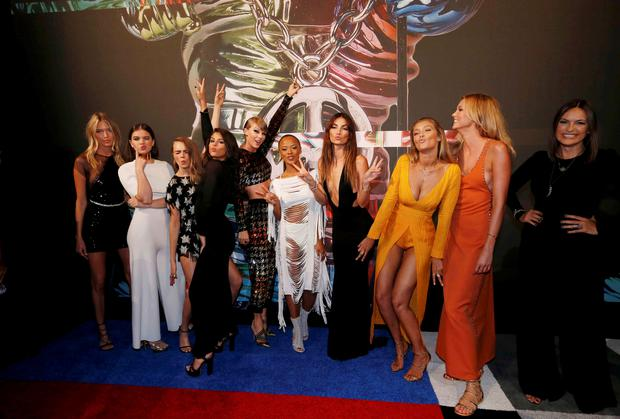 From left, model Martha Hunt, actress Hailee Steinfeld, model Cara Delevingne, recording artists Selena Gomez and Taylor Swift, actress Serayah McNeill, models Lily Aldridge, Gigi Hadid and Karlie Kloss, and actress Mariska Hargitay arrive together at the 2015 MTV Video Music Awards