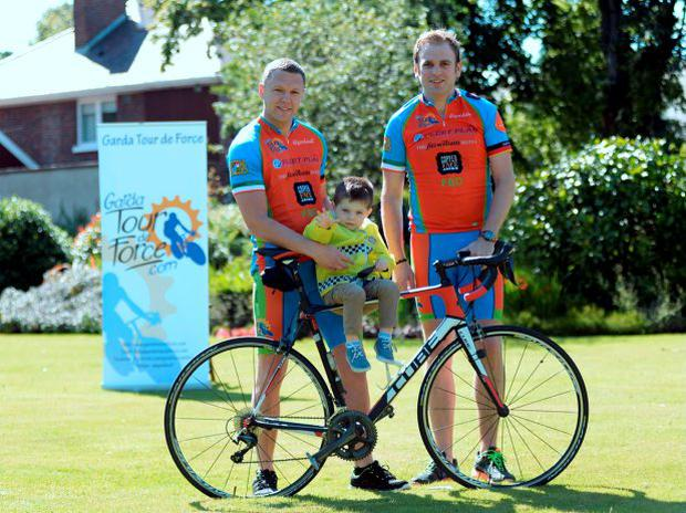 Darragh Kavanagh, 3, from Ashbourne with and Garda Mark Bennett, left, and Det. Garda Seamus O'Donovan, both from Criminal Task force, Kilmainham. Photocall for launch of the Garda Tour De Force Charity Cycle in aid of Pieta House. The cycle will run for 500kms through Belgium and France. Belgian Ambassador residence, Ailsbury Road, Ballsbridge, Dublin. Picture: Caroline Quinn