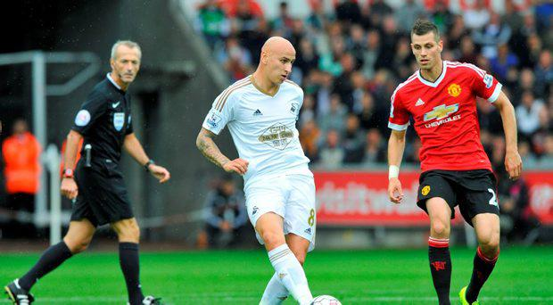 Manchester United's Morgan Schneiderlin in action with Swansea's Jonjo Shelvey