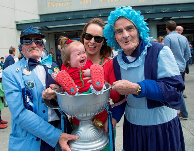 Dublin's Gerry & Molly Malone with Mayo fans Julie Higgins and one year old daughter Sadie before they head in to see Dublin V's Mayo in the All-Ireland SFC semi-final. 30/8/2015 Picture by Fergal Phillips