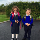 Eli Feerick heading off for his first day at St Aidan's National School, Kiltimagh, Co Mayo with his sister Amelie