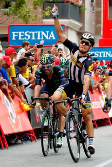 MTN-Qhubeka's Italian Kristian Sbaragli celebrates as he crosses the finish line to win the 10th stage of the Vueltathe