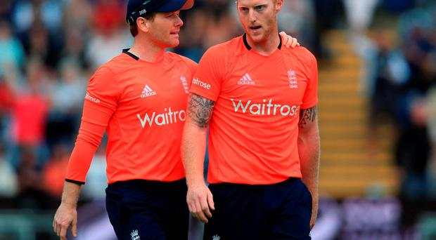 England captain Eoin Morgan speaks with teammate Ben Stokes (right) after taking the wicket of Australia's Nathan Coulter-Nile in the final over