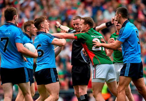 John Small, Dublin, gets involved in an altercation with Andy Moran, Mayo, as referee Joe McQuillan signals for a penalty for Mayo