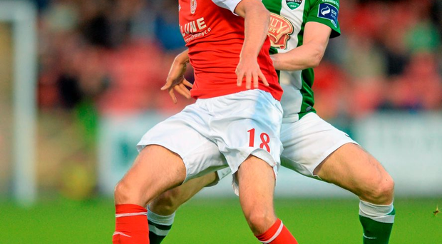 Sam Verdon, St Patrick's Athletic, in action against Colin Healy, Cork City