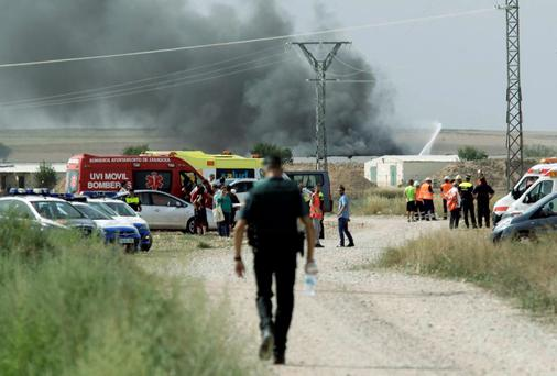 A column of smoke rises from a factory after an explosion at a fireworks factory on the outskirts of Zaragoza Credit: REUTERS/Luis Correas