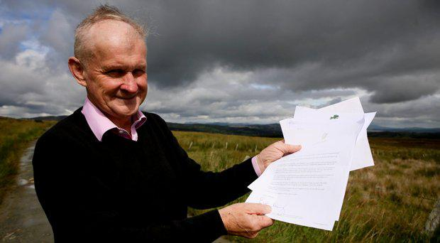 Micky Gallagher, postman and weather forecaster from Co. Donegal pictured with letters of best wishes on his retirement, including one from Enda Kenny