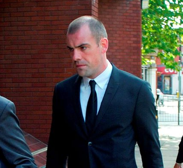 Everton footballer Darron Gibson (centre) arrives at Trafford Magistrates' Court in Sale, Cheshire, where he will appear accused of crashing his sports car into a cyclist while drink-driving. Photo credit: Tony Spencer/PA Wire