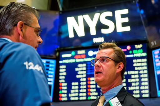 Traders work on the floor of the New York Stock Exchange shortly after the market opened in New York. Photo: Reuters