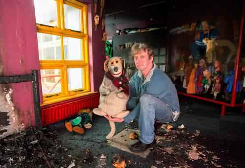 Lambert Theatre director Liam Lambert with an original Judge puppet as he surveys the damage caused to the puppet theatre by the fire