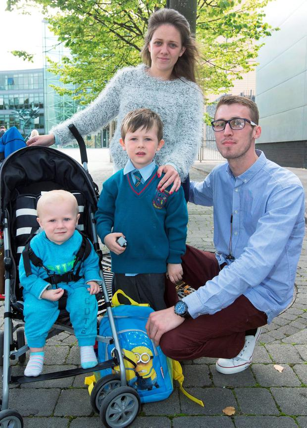 Marcus Fallon and his partner Nicole Mallon with their children Roman (4) and Lucas (14 months) at The Fingal County Council offices at Blanchardstown yesterday