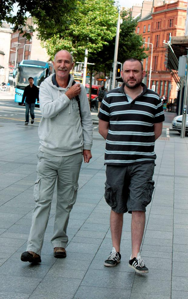 Concession-holders Martin O'Sullivan and Denis Forde arriving for the meeting of creditors of Clerys department store with the liquidators from KPMG