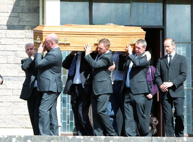 John O'Donoghue's coffin is carried in Doon, Co Limerick
