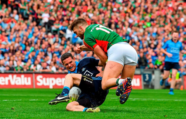 Stephen Cluxton, Dublin, is tackled by Aidan O'Shea, Mayo
