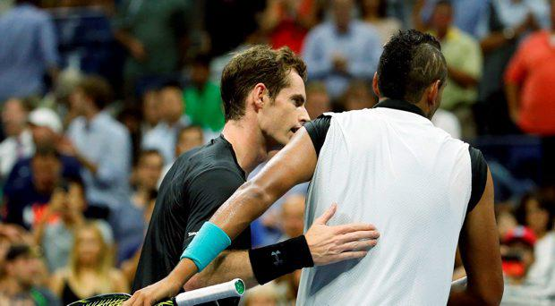 Andy Murray, left, of Britain, talks to Nick Kyrgios, of Australia, after beating him during the first round of the U.S. Open tennis tournament in New York, Tuesday, Sept. 1, 2015. (AP Photo/Julio Cortez)