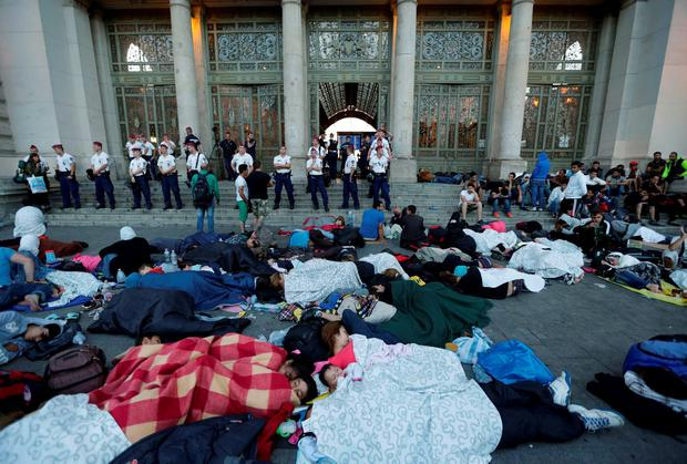 Migrants rest near the Keleti Railway Station in Budapest, Hungary, Wednesday, Sept. 2, 2015, after police stopped them from getting on trains to Germany. (AP Photo/Petr David Josek)