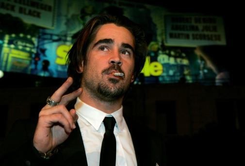 Actor Colin Farrell, smoking, arrives at the premiere of