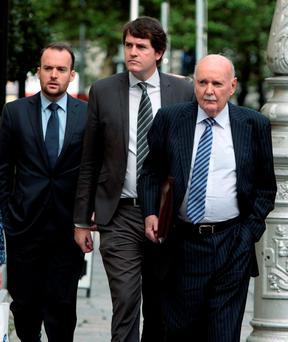 Michael Fingleton (far right), former chief executive of the Irish Nationwide Building Society, arriving at the Banking Inquiry at Leinster House yesterday. Photo: Tom Burke